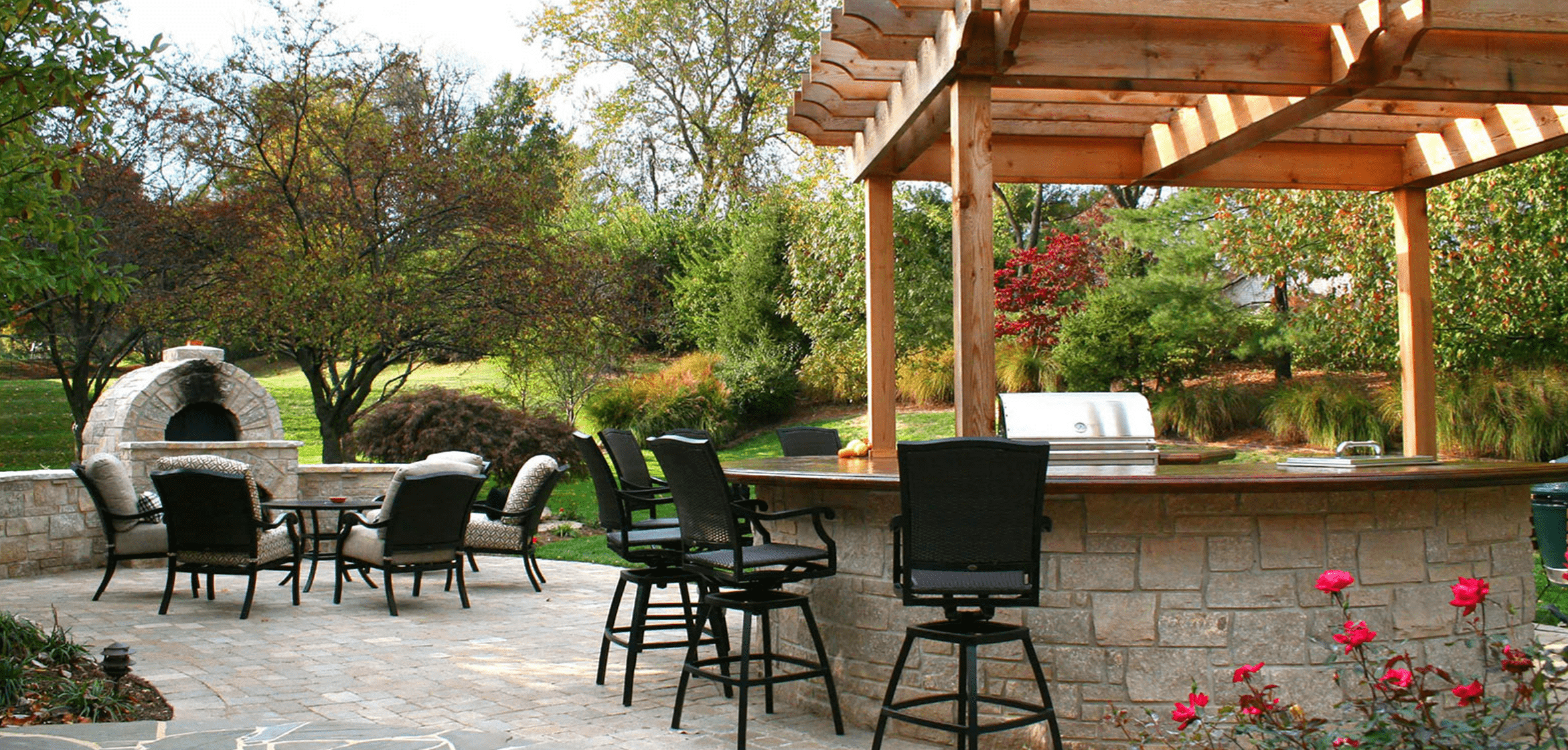 Patio with pergola over a masonry bar.